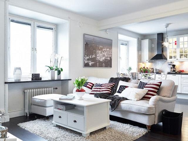 Воздушный интерьер совмещенных кухней-столовой и гостиной в скандинавском стиле